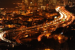 Wet night city: traffic closeup, Seattle, from high above on beacon hill, 12th and 13th floors PAC-MED building, Washington state, USA