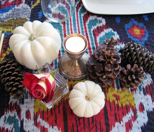 white pumpkins and pinecones and ikat table setting