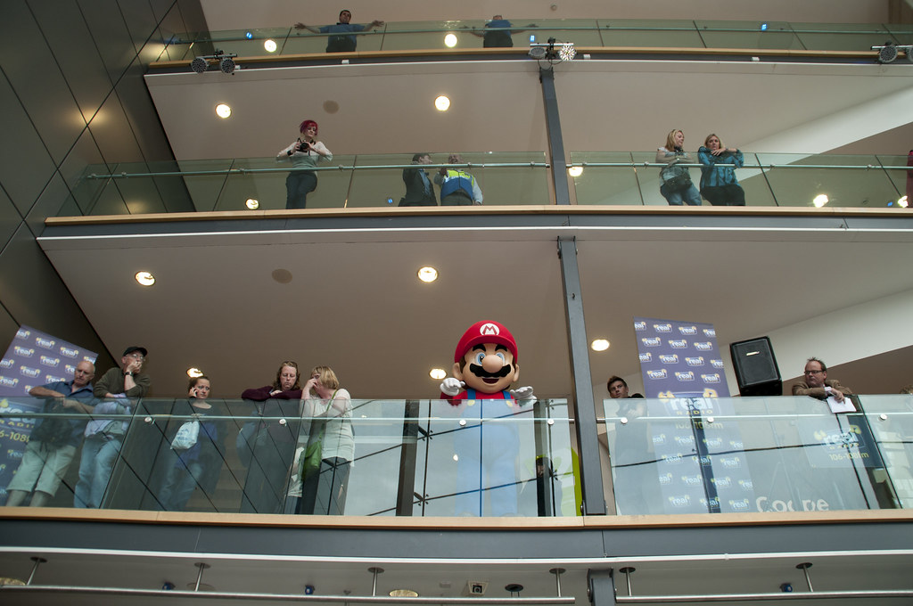 Mario waves from the balcony