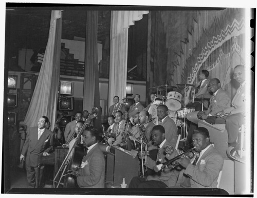 [Portrait of Duke Ellington, Ray Nance, Tricky Sam Nanton(?), Johnny Hodges(?), Ben Webster(?), Otto Toby Hardwick(e), Harry Carney, Rex William Stewart, Juan Tizol, Lawrence Brown, Fred Guy(?), and Sonny Greer, Howard Theater, Washington, D.C., early 194
