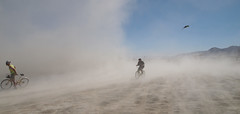 Dust bikers and a hang glider