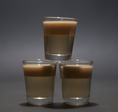 candle(0.0), beer glass(0.0), whisky(0.0), pint (us)(0.0), lighting(0.0), alcoholic beverage(0.0), old fashioned glass(1.0), espresso(1.0), cup(1.0), pint glass(1.0), drinkware(1.0), distilled beverage(1.0), glass(1.0), drink(1.0),