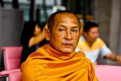 child(0.0), senior citizen(0.0), people(1.0), temple(1.0), man(1.0), monk(1.0), lama(1.0), person(1.0),