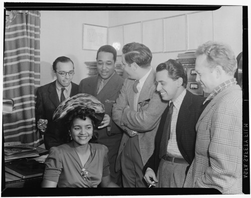 [Portrait of Ahmet M. Ertegun, Duke Ellington, William P. Gottlieb, Nesuhi Ertegun, and Dave Stewart, William P. Gottlieb's home, Maryland, 1941] (LOC)