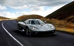 porsche carrera gt(0.0), race car(1.0), automobile(1.0), vehicle(1.0), performance car(1.0), automotive design(1.0), koenigsegg ccr(1.0), land vehicle(1.0), luxury vehicle(1.0), supercar(1.0), sports car(1.0),
