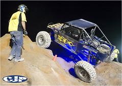 model car(0.0), stock car racing(0.0), dirt track racing(0.0), sprint car racing(0.0), toy(0.0), auto racing(1.0), automobile(1.0), racing(1.0), vehicle(1.0), off road racing(1.0), motorsport(1.0), off-roading(1.0), monster truck(1.0),