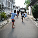 Bermain bola. : Children playing football in the street. Photo by Lalitya