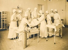 A photo of an unidentified medical persons working on a patient in an operating room