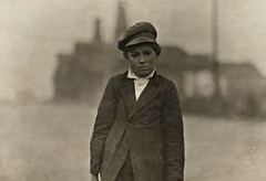 "7 A.M. Boy (""Bill,"") carrying milk. In summer he works in the glass factory and keeps two cows too, Marion, Indiana, by Lewis Wickes Hine 1908"