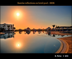 Sunrise reflections on hotel pool - HDR