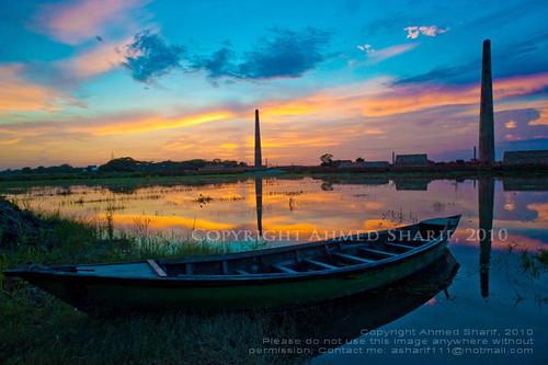 sunset chimney reflection water river boat nikon colours pollution dhaka char bangladesh buriganga brickfield nikkoraf20mmf28d d700 basila washpur