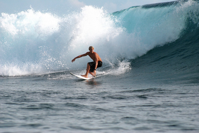 Another day riding the waves at Teahupoo.