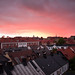 Glowing sky over rooftops by Anders Hammar