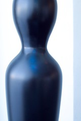 purple(0.0), glass bottle(0.0), drinkware(0.0), cobalt blue(0.0), bottle(0.0), glass(0.0), vase(0.0), wine bottle(0.0), mannequin(0.0), bowling pin(1.0), blue(1.0),