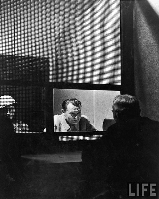 Goering conferring w. his lawyer during his trial, Nuremberg, by Ralph Morse 1945