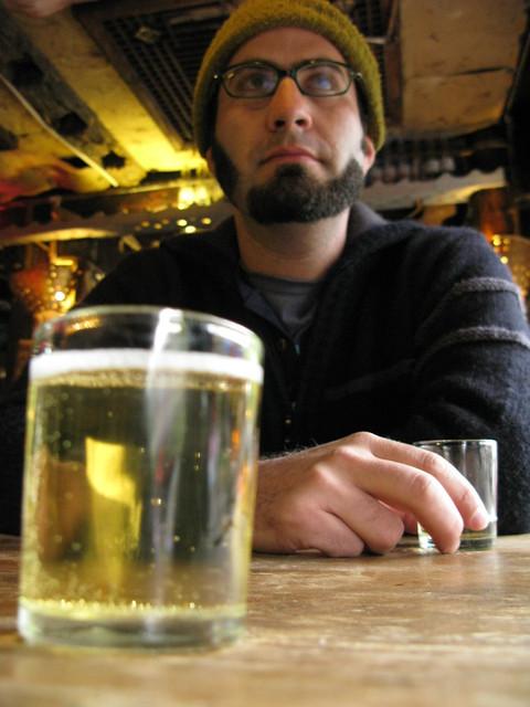 Todd and a tiny beer and a big beer - Lijiang, China