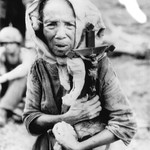 Filipino Woman Carries Family Cross to Safety, Nov. 6, 1944, Leyte, Philippines