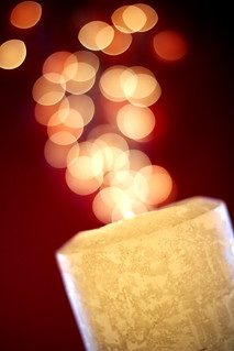 bokeh spitting candle