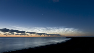 Noctilucent clouds over the ocean