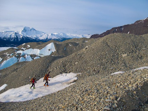 Dylan Taylor and Danny Uhlmann hiking Nizina Glacier moraines on a 100-mile ski/hike from Skolai Pass to McCarthy, Wrangell Mountains, Alaska.
