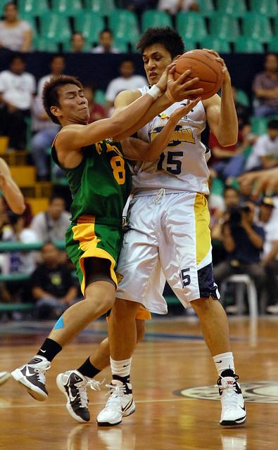 FEU's RR Garcia tries to steal the ball from NU's Jewel Ponferrada
