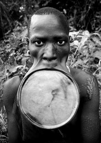 Surma woman with giant lip plate - Kibish Ethiopia by Eric Lafforgue
