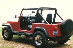 off-roading(0.0), jeep wrangler(0.0), automobile(1.0), automotive exterior(1.0), vehicle(1.0), compact sport utility vehicle(1.0), jeep cj(1.0), jeep(1.0), off-road vehicle(1.0), bumper(1.0), land vehicle(1.0),