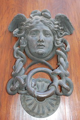 sculpture(0.0), door knocker(0.0), relief(0.0), monument(0.0), statue(0.0), carving(1.0), art(1.0), temple(1.0), stone carving(1.0),