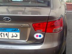 automobile(1.0), automotive exterior(1.0), vehicle(1.0), kia cerato(1.0), mid-size car(1.0), city car(1.0), compact car(1.0), bumper(1.0), sedan(1.0), land vehicle(1.0), vehicle registration plate(1.0), kia motors(1.0),