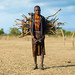 Erbore tribe girl carrying some wood on her back, Omo valley, Murale, Ethiopia by Eric Lafforgue