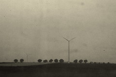 a landscape - on a grey afternoon - through a dirty train window - somewhere in northern france