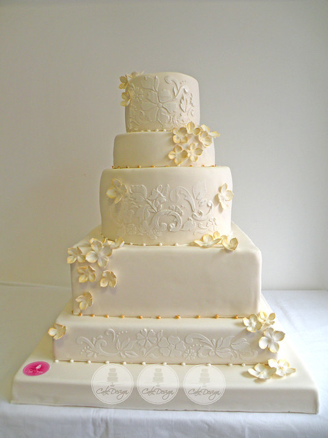 white and gold stenciled wedding cake