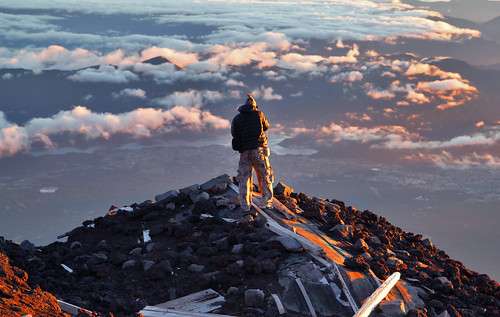 A photographer capturing view from Mt Fuji