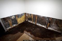 water damage under the master bedroom closet