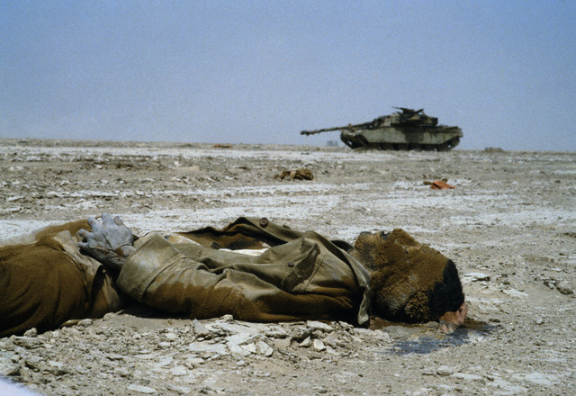 The body of an Iranian soldier and burnt out tank following combat that took place around Basra, the war was over a border dispute, by Jacques Pavlovsky 1982