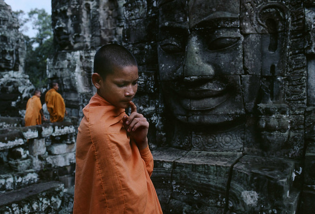 Buddhist Novices at Bayon, Angkor, Cambodia, 1999, by Steve McCurry