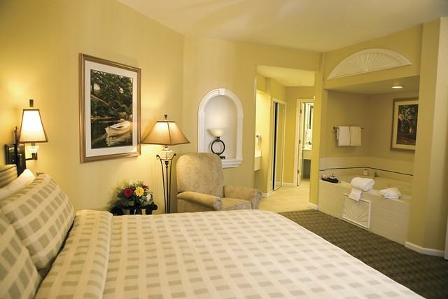 Villa master bedroom ltoward tub caribe royale orlando - Hotels that have 2 bedroom suites ...