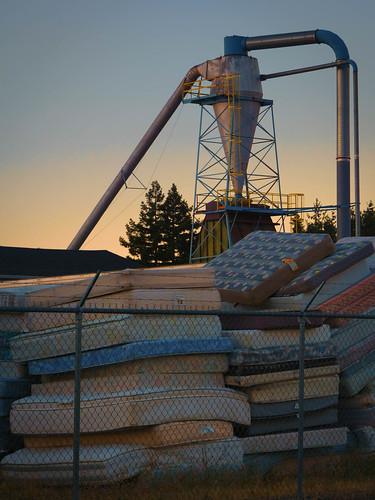lanecounty eugene builtlandscape oregon industriallandscape recycling goldenhour sunset hopper america mattresses pacificnorthwest fence pnw upperleftusa fences magichour