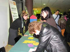 Signing action postcards outside the screening