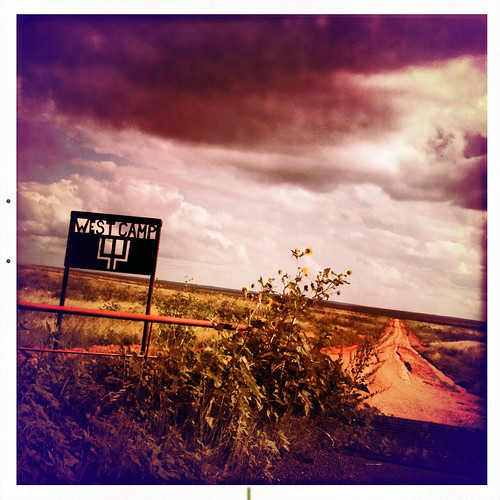 road ranch summer camp sky west rain weather sign clouds landscape texas tracks tire dirt sunflowers western thunderstorm pitchfork muddy
