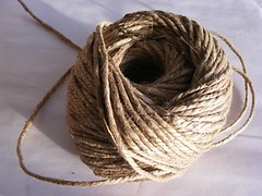 textile(0.0), wool(0.0), thread(0.0), art(1.0), brown(1.0), twine(1.0), rope(1.0),