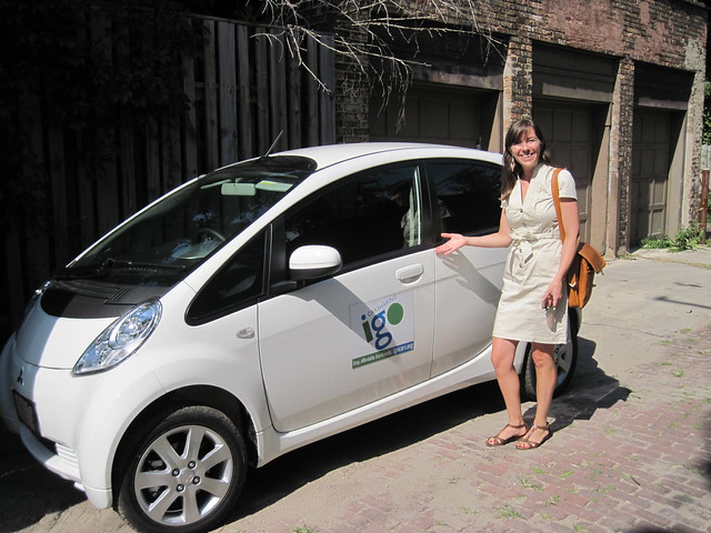 Emily Robinson shows off the new i-MiEV