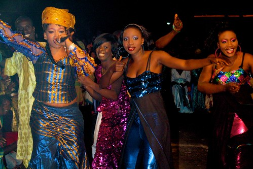 <p>Pop star and dancer Oumou Sow and her dance crew, Les Amazones, perform a number for their neighborhood crowd.</p>