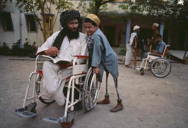 Victims of violence, Kandahar, Afghanistan, 1985, by Steve McCurry
