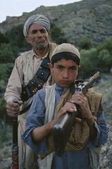 Father and son fighting against the government, Kunar, Afghanistan, 1980, by Steve McCurry