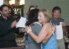 PEARL HARBOR (Sept. 1, 2010) Michelle Blancas, spouse of Chief Yeoman Alex Blancas, is congratulated by Andy Walsh after receiving a free makeover gift package through the Operation Makeover program. (U.S. Navy file photo)