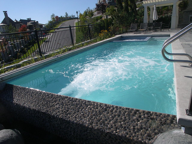 Natural Stone Infinity Edge Pool And Spa Combination With Badu Stream Swim Jets Flickr Photo