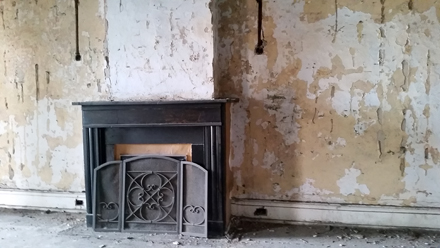 Peeling Paint and Rusted Fireplace