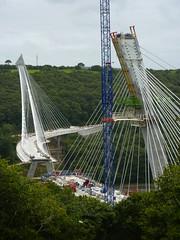 mast(0.0), rope bridge(0.0), net(0.0), amusement ride(0.0), suspension bridge(1.0), bridge(1.0),