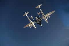 VMS EVE carries VSS Enterprise on her first manned flight across the blue skies of Mojave. Photo by Mark Greenberg